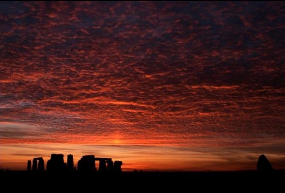 Stonehenge under a red sky